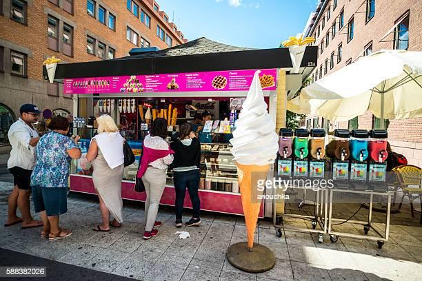 People buying ice-cream on Stockholm street, Sweden