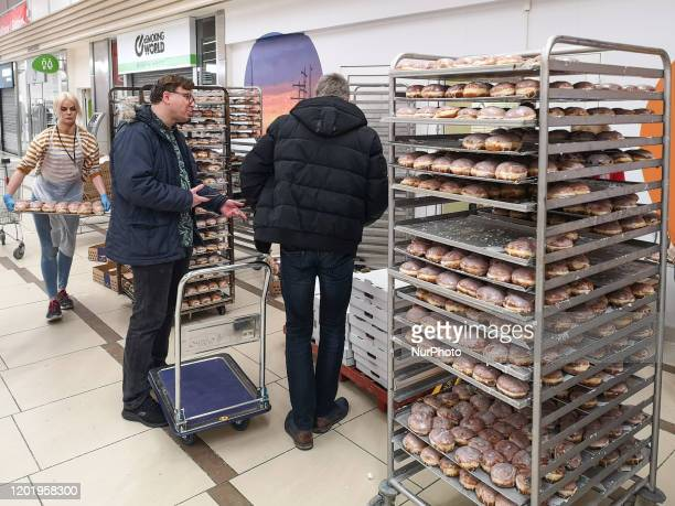 People buying paczki traditional fistsized donut filled with rose marmalade are seen on 20 February 2020 in Gdansk Poland Fat Thursday is a...