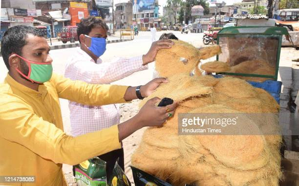 People buying sevai or rice vermicelli from a roadside stall at Kantatoli locality on May 22, 2020 in Ranchi, India. Sevai is used to prepare sheer,...
