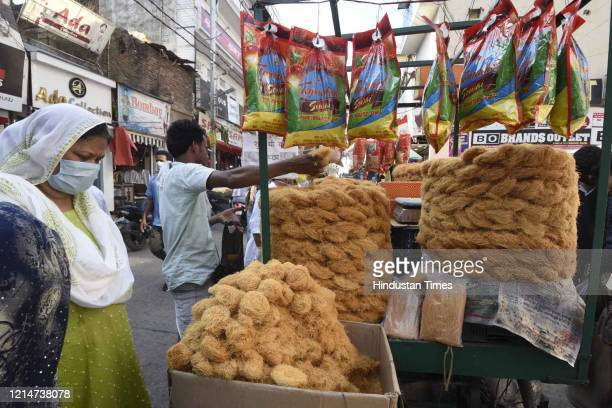 People buying sevai or rice vermicelli from a roadside stall on May 22, 2020 in Patna, India. Sevai is used to prepare sheer, a traditional Eid...