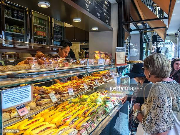 People buying snacks on Rivoli street, Paris, France