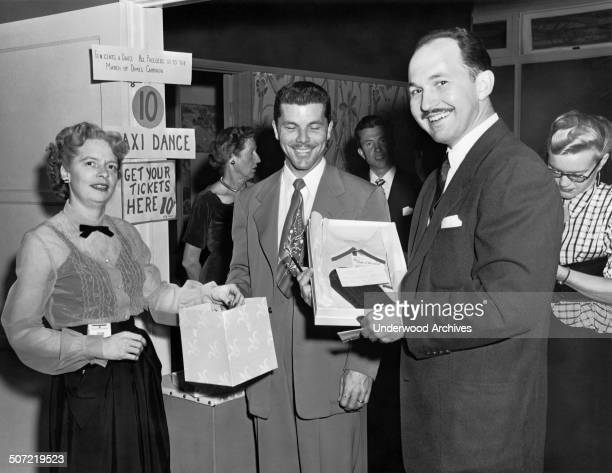 People buying tickets for a taxi dance benefit for the March of Dimes California late 1940s or early 1950s