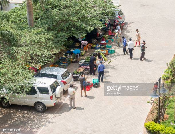people buying vegetables in india virus lockdown - lockdown stock pictures, royalty-free photos & images