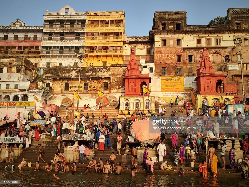 People By Ganges River Against Building : Stock Photo