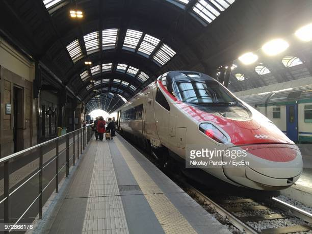 People By High Speed Train At Railroad Station Platform
