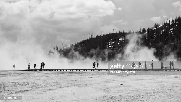 people by hot spring at yellowstone national park - elia karli stock-fotos und bilder