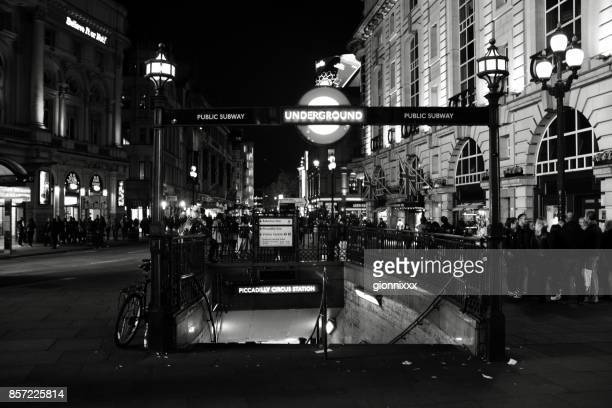 People by night in Piccadilly Circus, London, England