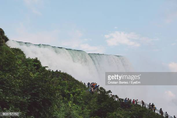people by waterfall against sky - bortes stock pictures, royalty-free photos & images