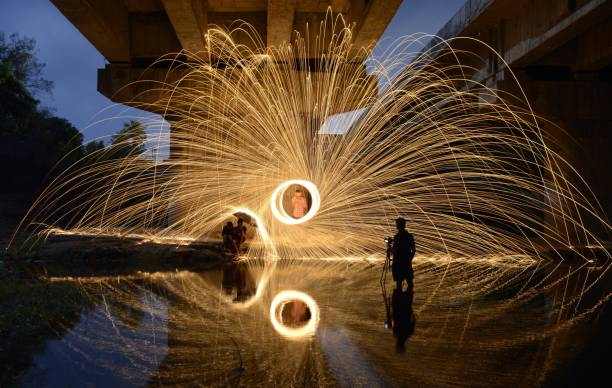 People By Wire Wool At Night