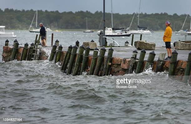 People came out to see Tropical Storm Henri as it lashed Mattapoisett Harbor on the South Coast at high tide in Mattapoisett, MA on Aug. 22, 2021.