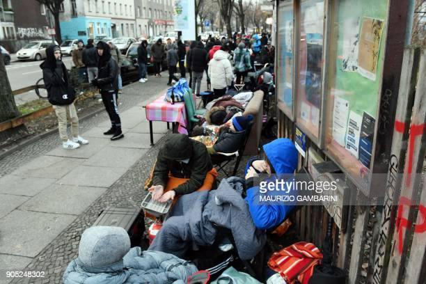 People camp out as the wait in line to buy the new limitededition sports shoes of German sports goods company Adidas and Berlin's transport company...