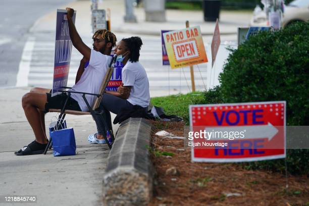 People campaign for a candidate for office outside a polling location on June 9, 2020 in Atlanta, Georgia. Georgia, West Virginia, South Carolina,...