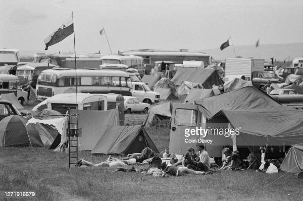 People camping under the Welsh flag at Stonehenge in Wiltshire during the Summer Solstice 21st June 1985