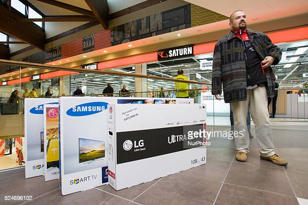 People can be seen buying tv's a the newly opened Saturn electronics store in the Zielony Arkady mall on Friday The recently elected government set...