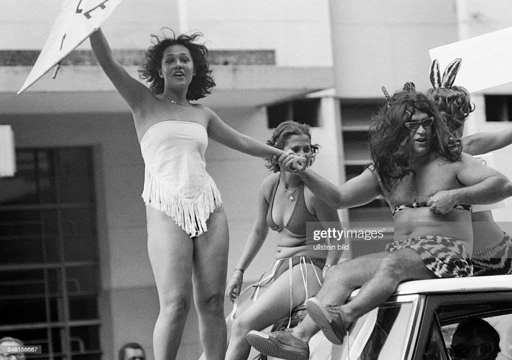people, carnival procession, sexuality, two young girls and a man on a festival carriage, semi-nude, aged 20 to 30 years, aged 30 to 40 years, Brazil, Minas Gerais, Belo Horizonte - 31.01.1978 : News Photo