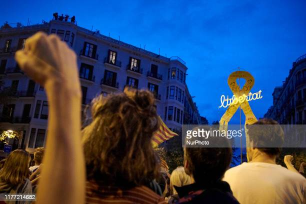 A people carries a yellow ribbon with the word ''freedom'' during a protest called by ''Picnic for the Republic'' proindependence movement outside...