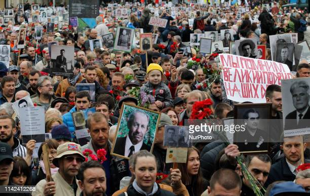 People carries portraits of veterans of the WWII as they participate in the socalled Immortal Regiment march in Kiev Ukraine 9 May 2019 Ukraine...