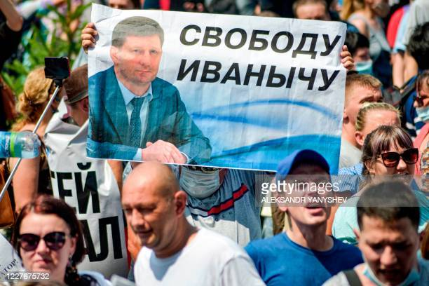 People carry a banner reading Freedom for Furgal during an unauthorised rally in support of Sergei Furgal the governor of the Khabarovsk region who...