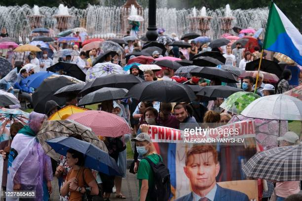 People carry a banner reading Return Furgal for us during an unauthorised rally in support of Sergei Furgal in the Russian far eastern city of...
