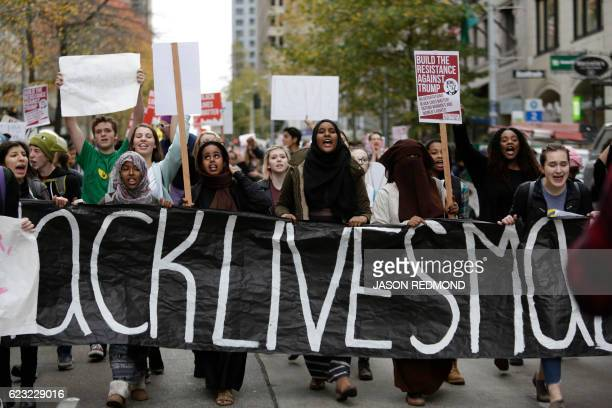 People carry a 'Black Lives Matter' banner during a student walkout protest against US Presidentelect Donald Trump in Seattle Washington on November...