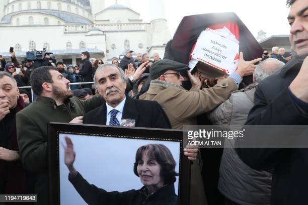 People carry a coffin of Rahsan Ecevit, wife of late Turkish Prime Minister Bulent Ecevit, during her funeral ceremony at the Kocatepe Mosque in...