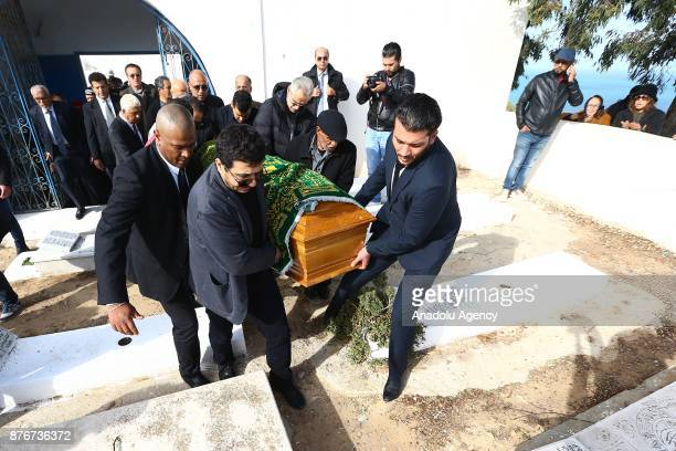 People carry a coffin of Tunisian fashion designer Azzedine Alaia who died in aged 77 in Paris during the funeral ceremony at the Sidi Bou Said...