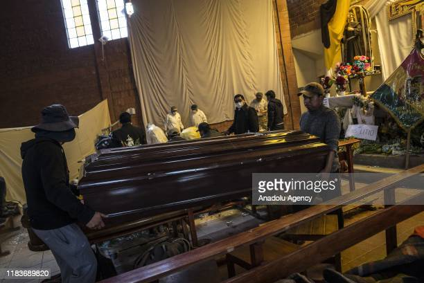 People carry a coffin which contains the body of a killed man during clashes to perform an autopsy at San Francisco de Asis Church in Senkata, a...