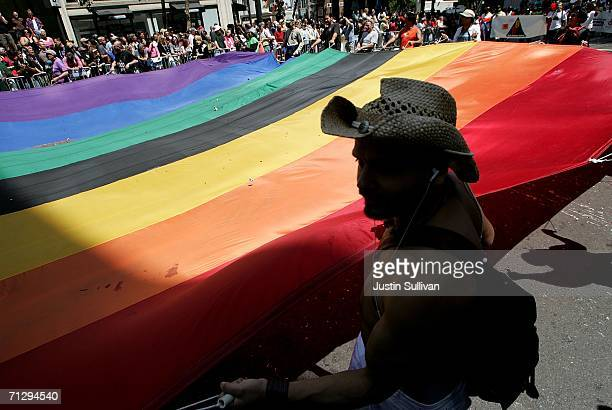 People carry a large gay pride flag during the 36th annual LGBT Pride Parade June 25, 2006 in San Francisco. Hundreds of thousands of spectators...