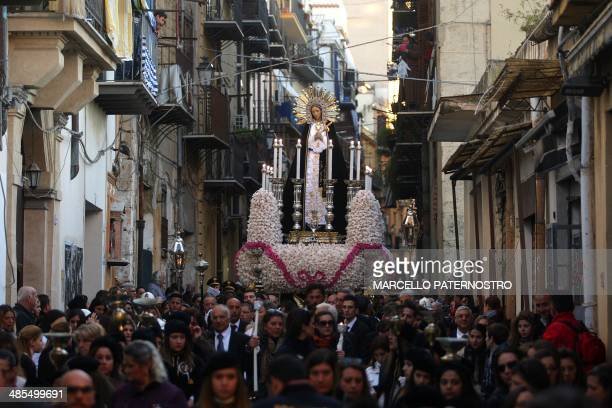 People carry a statue of the Virgin Mary during a procession in the center of Palermo as part of the Good Friday celebrations on April 18 2014 AFP...