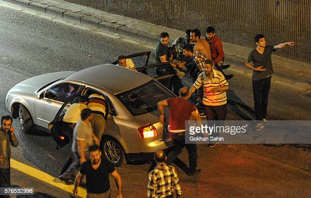 People carry a wounded man July 16 2016 in Ankara Turkey Istanbul's bridges across the Bosphorus the strait separating the European and Asian sides...