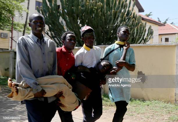 People carry a wounded person as Nigerian Shias gather during the Arbaeen ceremony to mark 40day mourning period that follows the anniversary of the...