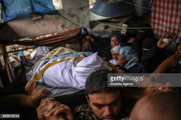 People carry body of Nidal alJafari border security officer who lost his life on the suicide attack carried out at Rafah Border Gate during funeral...