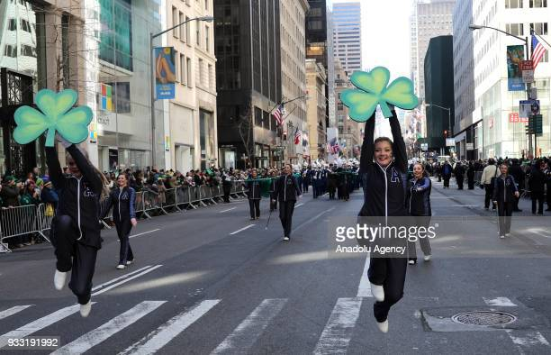 People carry clover leaves during the annual St Patrick's Day parade along 5th Avenueon March 17 2018 in New York United States