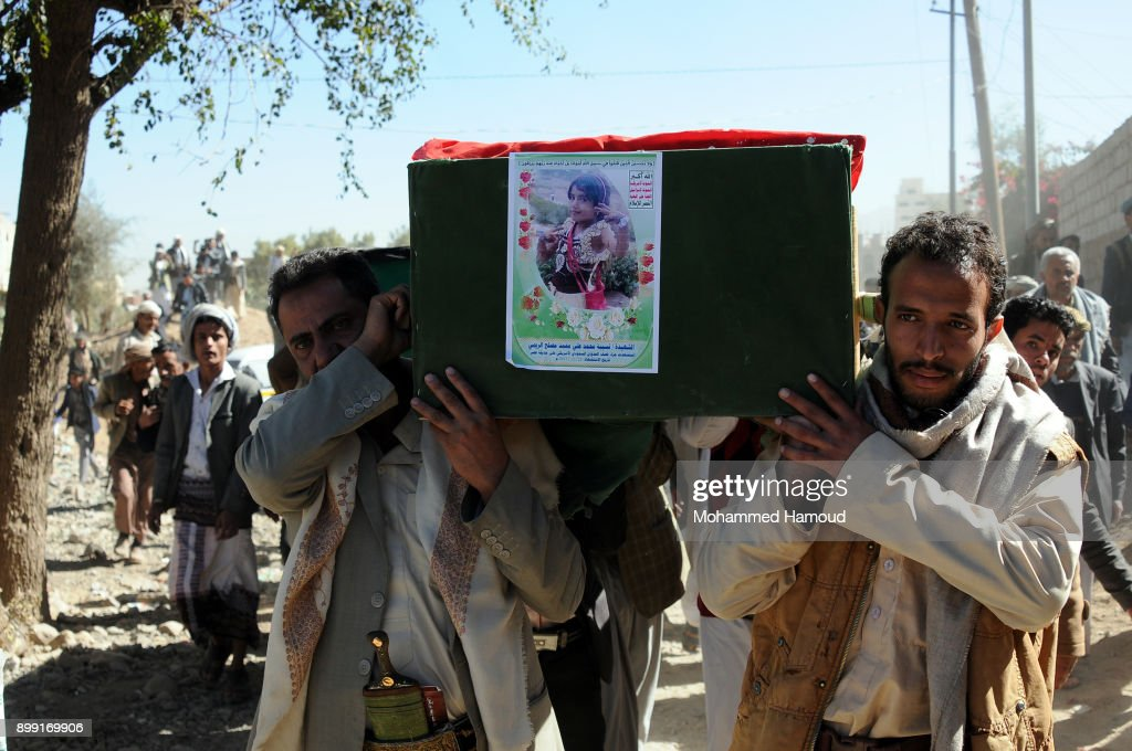 People carry coffins of 11-members from one family after they were killed by airstrikes carried out by the Saudi-led coalition hit their house on Monday leaving the nine members including five children killed on December 26, 2017 in Sana'a, Yemen. The Houthi-run Saba news agency reported that at least 71 civilians, including 11 children, were killed in Yemen in 51 airstrikes carried out by the Saudi Arabia-led military coalition across the country over a 48-hour period.