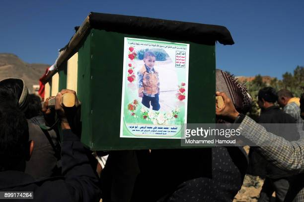 People carry coffins of 11members from one family after they were killed by airstrikes carried out by the Saudiled coalition hit their house on...