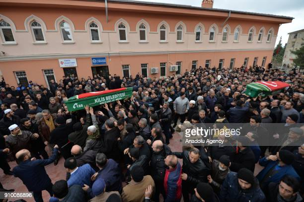 People carry coffins of Muzaffer Aydemir and Tarik Tabbak who lost their lives after members of PKK/PYD terrorist organization in Afrin launched...