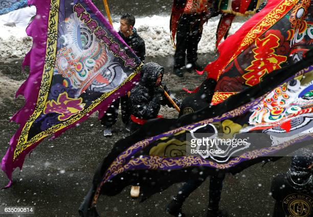 People carry flags and banners as they celebrate Chinese New Year in Boston's Chinatown neighborhood on Feb 12 2017
