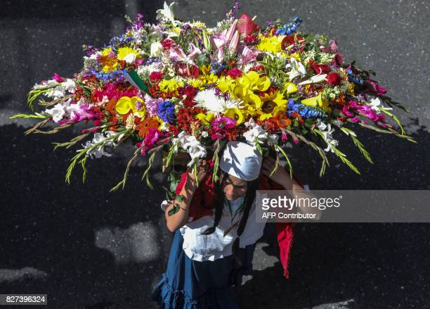 People carry flower arrangements during the traditional Silleteros parade held as part of the Flower Festival in Medellin Antioquia department...