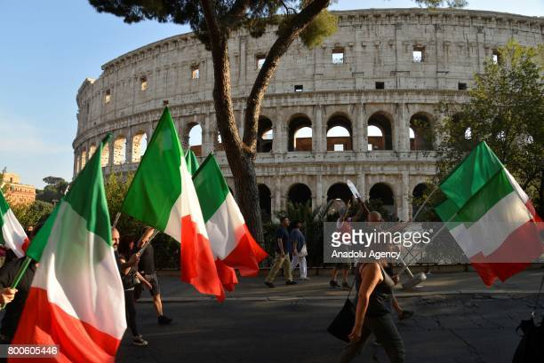 People carry Italian flags during a protest against the law on Jus Soli which would give birthright citizenships to children born to refugees living...