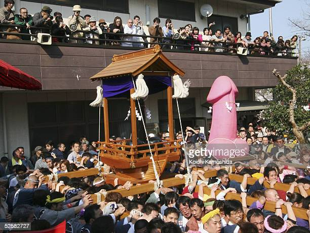 People carry large pink and black phalluses as part of the annual Utamaro Festival April 3 2005 in Kawasaki Japan The Utamaro Festival is...