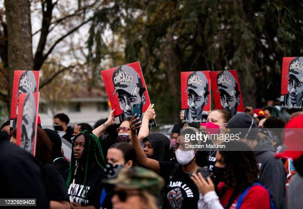 People carry portraits of Daunte Wright as they march to the Brooklyn Center police headquarters on May 2, 2021 in Brooklyn Center, Minnesota....