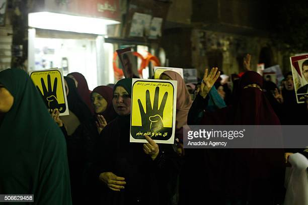 """People carry posters of first democratically elected President of Egypt Mohamed Morsi and """"Rabia Sign"""" during the protest against military regime on..."""