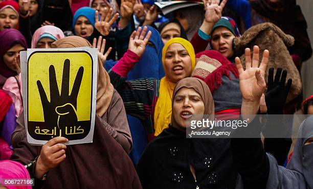 People carry posters of first democratically elected President of Egypt Mohamed Morsi and 'Rabia Sign' during the protest against military regime on...