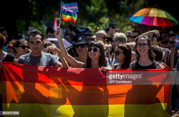 People carry rainbowcoloured banners and flags during the Gay Pride parade on June 24 2017 in Belgrade The march was held without incidents amid...