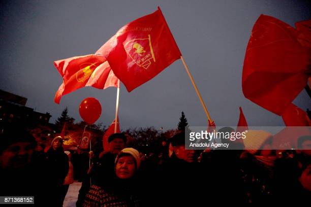 People carry red flags and balloons as the Russian Communist Party rallies to mark the centenary of the 1917 Bolshevik Revolution in Novosibirsk...