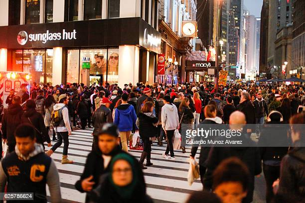 People carry retail bags during Black Friday events on November 25 2016 in New York City The day after Thanksgiving called Black Friday is typically...