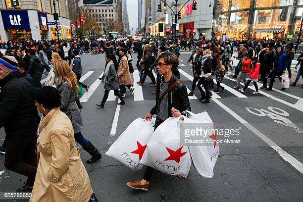 People carry retail shopping bags during Black Friday events on November 25 2016 in New York City The day after Thanksgiving called Black Friday is...