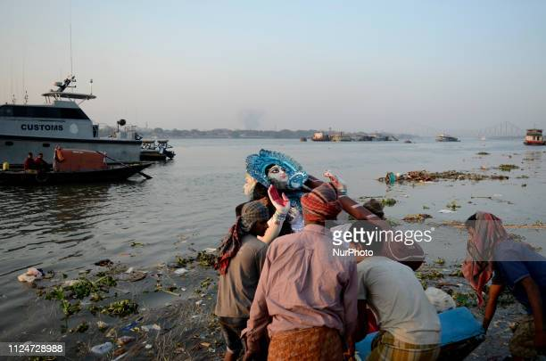 People carry Saraswati idol for immersion on the banks of the river Ganges in Kolkata India