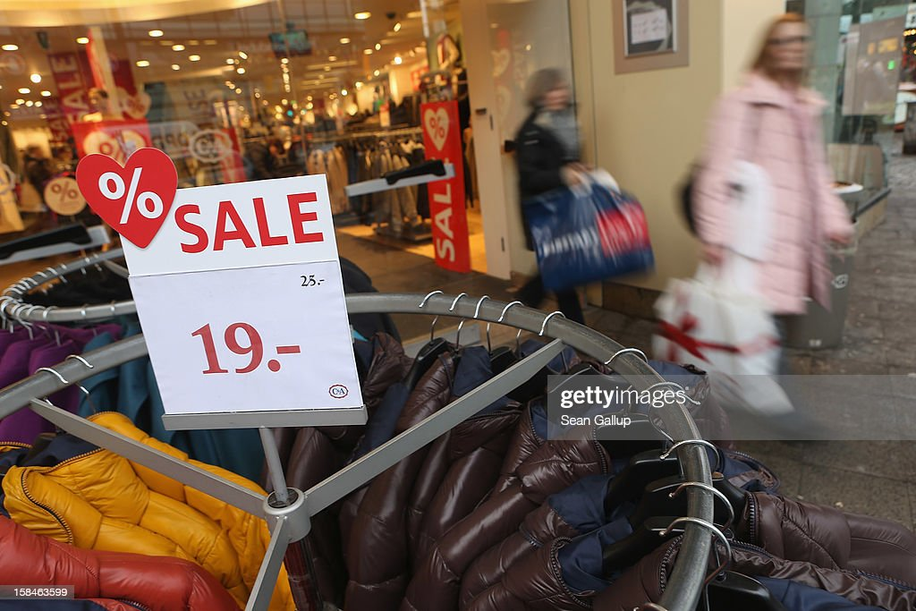 People carry shopping bags as they leave a C&A department store on a busy shopping street in Steglitz district on December 17, 2012 in Berlin, Germany. Retailers are hoping for a strong Christmas season in Germany, one of the few countries whose economy has so far weathered the current Eurozone debt crisis relatively well.