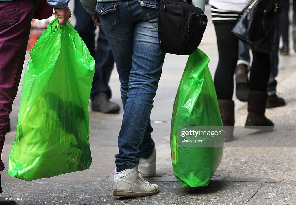 People carry shopping bags on Broadway in Manhattan on February 13, 2013 in New York City. The Commerce Department reported that retail sales were only up slightly in January following tax increases and high gas prices.